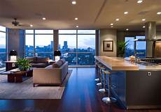 eclectic single bedroom apartment with open floor modern open floor plan kitchen completed by bulthaup