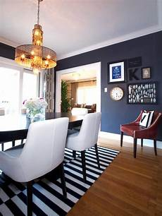 eclectic dining room with blue suede wallpaper striped rug hgtv