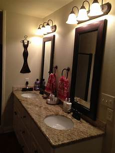 rubbed bronze mirror bathroom beige granite white cabs mirror frame rubbed