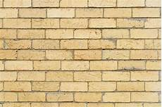 background and texture of light color brick wall surface photo premium download