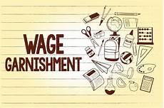 wage oder waage writing note showing wage garnishment business photo