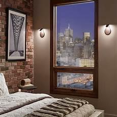 on trend wall sconces in the bedroom design necessities lighting