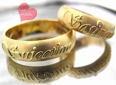materialise creativity 18k yellow gold name embossed engagement rings