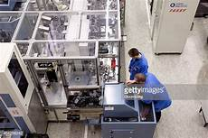 siemens ag amberg employees work on the automated assembly line at the