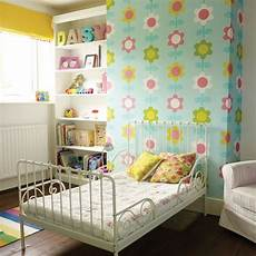 Yellow And Green Bedroom Decorating Ideas by Yellow And Green Bedroom With Floral Chimney Breast