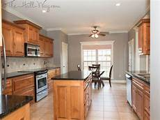 cherry kitchen cabinets with gray wall and quartz countertops ideas kitchen favs decor oak