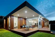 modern home design in au with a massive triangular shed roof