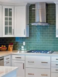 white kitchen with olive green tile backsplash hgtv