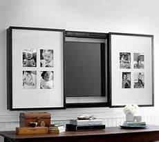 Fernseher Im Wohnzimmer Verstecken - pictures frames on sliding doors to hide tv screen on the