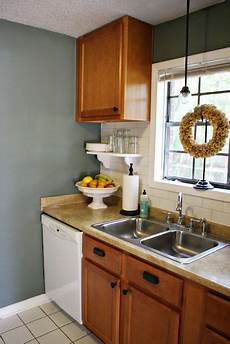 i love blue wall paint against oak cabinets if you re stuck with oak cabinets that is