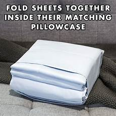 fold your sheets this way your friends will think you re a genius keep the sheets in your bed