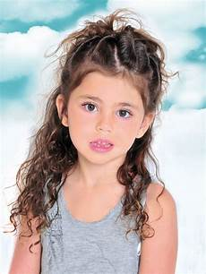 girls long hairstyle with twists and tousles