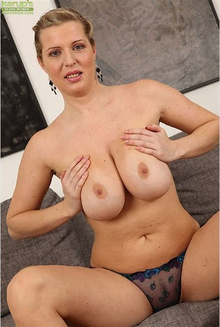 Busty mature woman Britney unleashes huge all natural ...