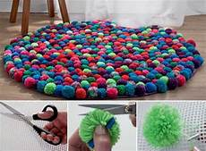 pom pom rugs are a easy diy to try the whoot