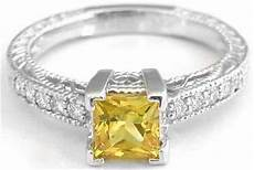 yellow sapphire engagement ring and matching fitted wedding band in 14k white gold with
