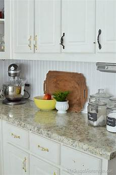 6 ways to redo a backsplash right over the old one the budget decorator