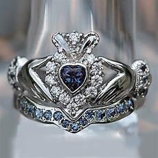heart shape sapphire and d vvs1 accents 10k white gold