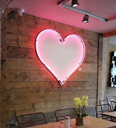 heart shaped mirror lit in neon pink neon signs neon light up
