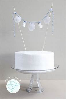 learn how to make a diy seashell cake topper bunting banner