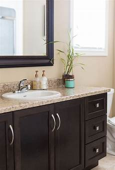 Bathroom Ideas Brown Cabinets by Brown Cabinets With A Granite Countertop Beautifully