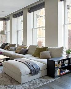 big comfy white sectional wall of windows loft