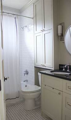 Bathroom Cabinet Ideas Above Toilet by White And Gray Bathroom Storage Above Toilet