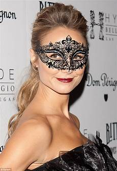 masked beauty stacy keibler is the belle of the masquerade ball in a stunning black corseted