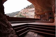 an innovative house carved out of a this luxury house is carved into a mountain ewmoda