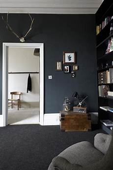 paint colors that go with grey and black dramatic living room with black walls interior design