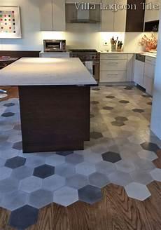Kitchen Floor Tile Or Hardwood by This Beautiful New York City Installation Flows Hardwood