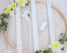 diy hula hoop wreath with photos is beautiful and easy on the budget