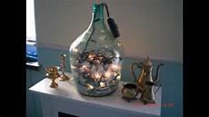 dekorieren mit lichterketten weihnachten lichterkette weinballon mit window creme