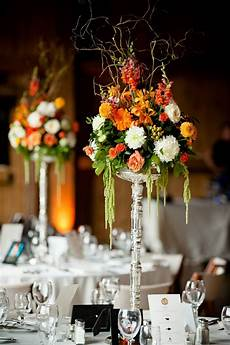 diy tall wedding centerpieces while the long tables had wood planks that ran down the middle