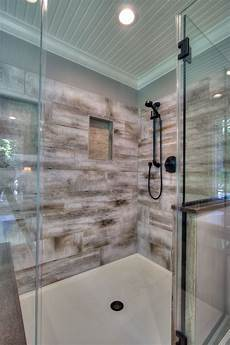 Bathroom Porcelain Tile Ideas Generous Walk In Shower With Bench Seating Has Wood Look