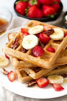 light crisp flourless oatmeal waffles running with spoons