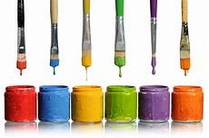 paintbrushes into paint containers hd free foto