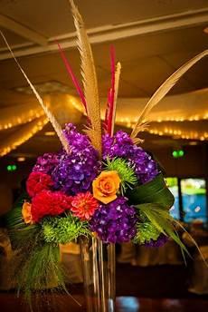 orange and purple wedding centerpieces wedding reception flowers feathers unique floral