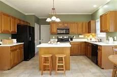 image result for best wall color with golden oak cabinets green kitchen walls honey oak