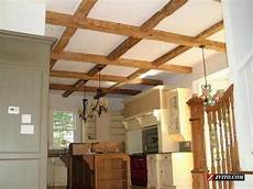 interior beams truss mantle rustic wood reclaimed weathered siding reclaimed antique barn wood siding