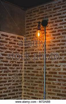 decorative edison style light bulbs against brick wall 90266008 alamy