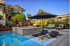 mini pool terrasse pool with patio tub and submerged lounge chairs hgtv