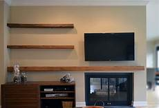 made reclaimed lumber floating shelves by abodeacious