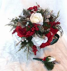 red and white winter wedding bouquet and boutonniere