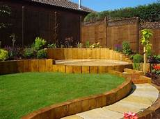 This Sloped Garden Has Curved Landscaping With The Slope