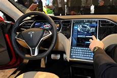 interior model e tesla porsche apple said to have considered buying tesla working on