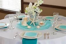 bliss wedding reception table blue turquoise white organza starfish shells sand