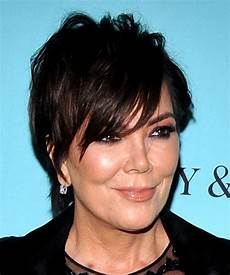 kris jenner short straight casual shag hairstyle with layered bangs black hair color