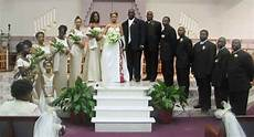 black people wedding reception dancing young with theirwedding party at the people s