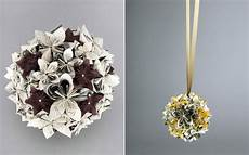 a bicycle built for two flowers made from old books and paper