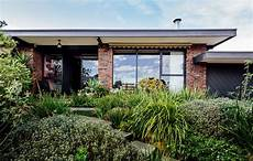 a beautiful melbourne house that connects with its a lovingly restored 1960s sibbel house in melbourne s